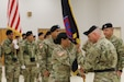 FORT SHAFTER FLATS, Hawaii - 9th Mission Support Command Commanding General Brig. Gen. Douglas Anderson passes the 9th MSC unit colors to Command Sgt. Maj. Jessie Baird, symbolizing passing the responsibility for the unit during the official assumption of command ceremony here Oct. 20, 2018.