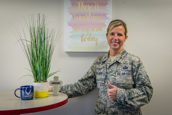 Maj. Shannon Walker, 514th Force Support Squadron commander, poses for a photo  in her office at Joint Base McGuire-Dix-Lakehurst.