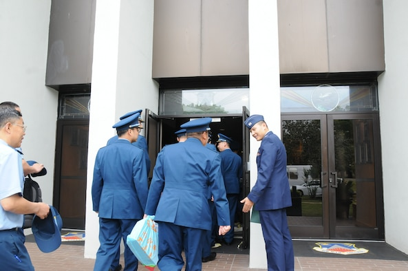 Midday and middle of the week, a wave of blue and navy uniforms washed over the inner circle of Air War College.