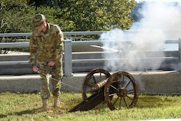 A Soldier from the 2nd Squadron of the 278th Armored Cavalry Regiment, Tennessee National Guard, shoots off the first of a three-shot volley from a cannon to dedicate Dale Hollow Dam during the 75th Anniversary Commemoration of Dale Hollow Dam and Reservoir in Celina, Tenn., Oct. 19, 2018.  Because the work to complete Dale Hollow Dam finished in 1943 during World War II, the Corps of Engineers never officially dedicated the dam, which is customary with these projects. (USACE photo by Lee Roberts)