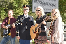 Lt. Col. Cullen Jones, U.S. Army Corps of Engineers Nashville District commander, poses with Banjoist Brandy Miller (Right), Recording Artist Delnora Reed Acuff and Guitarist Joe Dean in front of the Tennessee Historical Marker recognizing the significance of Dale Hollow Dam and Powerhouse, and Reservoir. The musicians performed music of the period of the 1940s during the 75th Anniversary Commemoration of Dale Hollow Dam and Reservoir Oct. 19, 2018. (USACE photo by Lee Roberts)