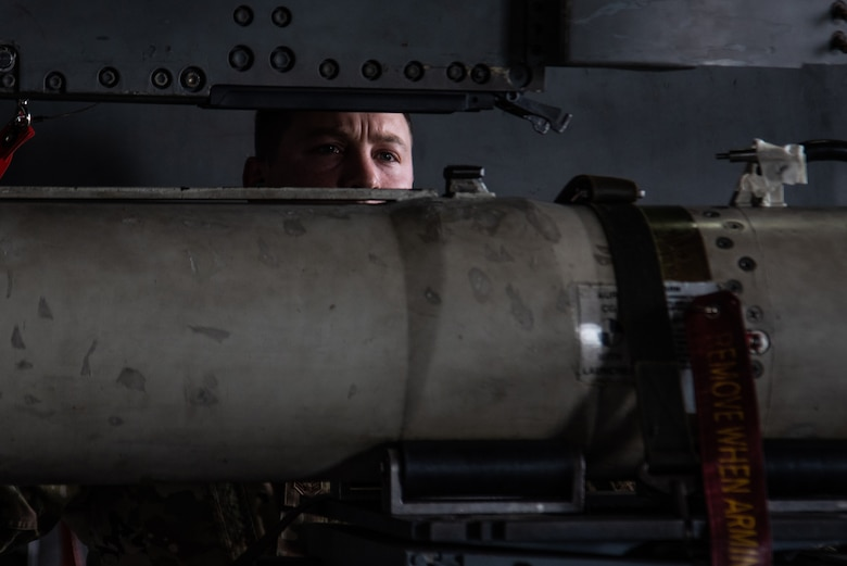 U.S. Air Force Staff Sgt. Justin Tankersley, 20th Maintenance Group weapons lead crew chief, double checks the new tool he created to ensure it is properly secured on a munition at Shaw Air Force Base, S.C., Oct. 16, 2018.