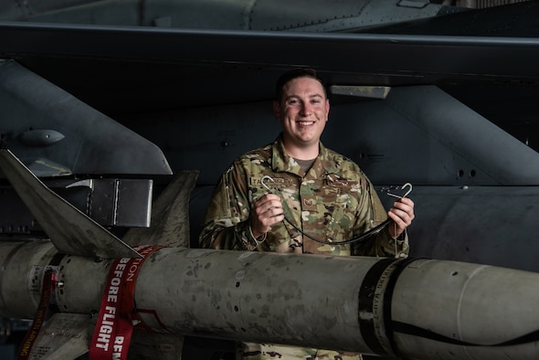 U.S. Air Force Staff Sgt. Justin Tankersley, 20th Maintenance Group weapons lead crew chief, holds up the tool he invented to save the Air Force time and money at Shaw Air Force Base, S.C., Oct. 16, 2018.