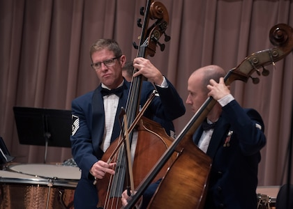 Master Sgt. Matthew Murray, left, and Tech. Sgt. Jonathan Davies, right, U.S. Air Force Band musicians, play the string bass at the V. Sue Cleveland High Concert Hall in Rio Rancho, N.M., Oct. 17, 2018. The band performed in five locations across N. M. and Texas and will continue to an additional seven cities, with a final concert scheduled for Oct. 27 in Allen, Texas. (U.S. Air Force photo by Senior Airman Abby L. Richardson)