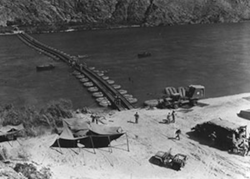 Here Army engineers practice constructing pontoon bridges across the Colorado River