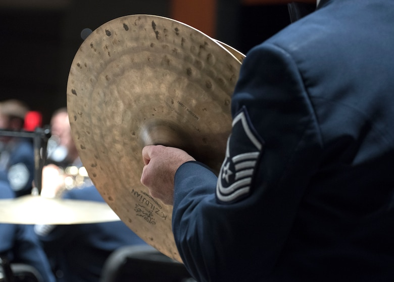 Master Sgt. Mark Dinitz, U.S. Air Force Band percussionist, plays the cymbals at the Wagner Noël Performing Arts Center in Midland, Texas, Oct. 21, 2018. The band performed in locations across New Mexico and Texas to inspire and engage the local communities. (U.S. Air Force photo by Senior Airman Abby L. Richardson)
