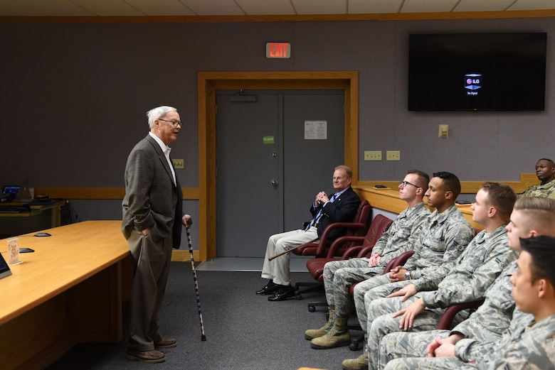 Retired U.S. Air Force Col. Harlan Bruha, former Air Force School of Applied Cryptologic Sciences commander, speaks during the 60-year anniversary of intelligence training in the Piper Auditorium at Sebers Hall on Goodfellow Air Force Base, Oct. 19, 2018. Bruha spoke about what Goodfellow was like when he was a commander. (U.S. Air Force photo by Staff Sgt. Joshua Edwards/Released)