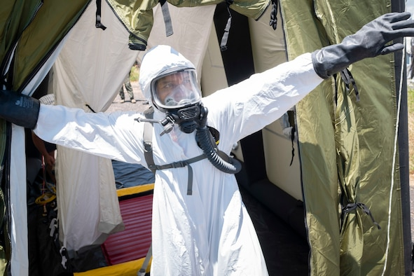 Staff Sgt. James Almero, 154th Medical Group Detachment 1, search extraction rescue operations technician, exits a decontamination tent
