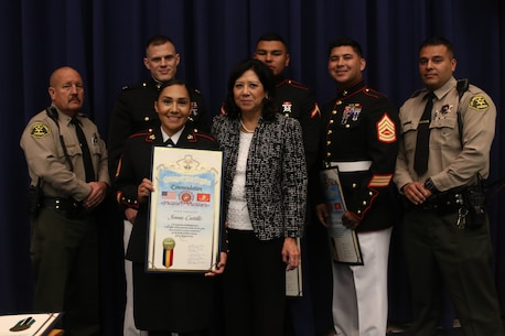 Staff Sgt. Jennie Castillo poses for a photo with members of the Board of Supervisors from the County of Los Angeles and members of the Los Angeles Police Department at the Kenneth Hahn Hall of Administration, CA, Oct. 16, 2018. Castillo is a native of Santa Ana, CA. Castillo was awarded the County of Los Angeles Commendation by the Board of Supervisors for applying first aid to a high school student, saving his life