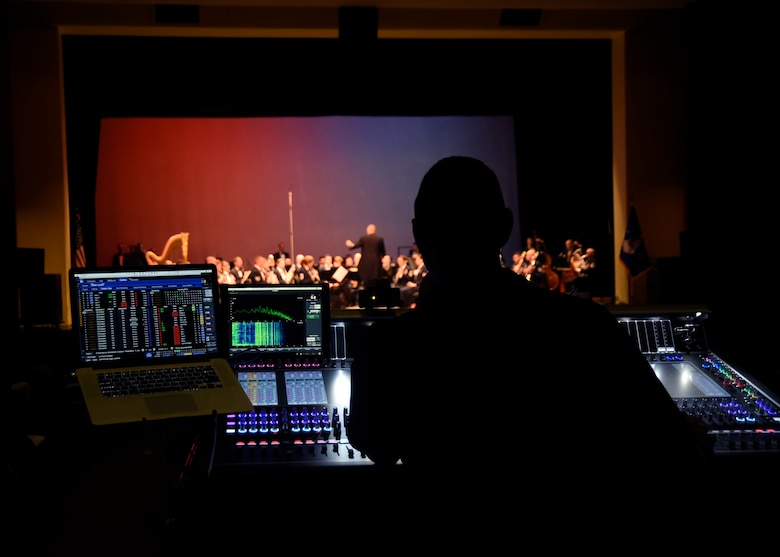 Master Sgt. Loren Zimmer, U.S. Air Force Band audio engineer, operates the front of house console during an Air Force Band performance at Los Alamos High School in Los Alamos, N.M., Oct. 16, 2018. The band performed in locations across N.M. and Texas to inspire and engage the local communities. (U.S. Air Force photo by Senior Airman Abby L. Richardson)