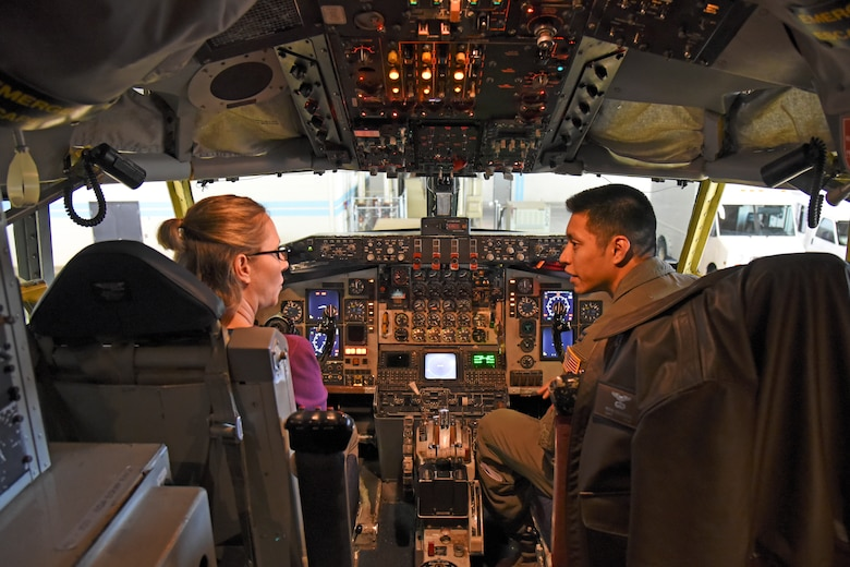 Capt. Kevin Escobedo, 92nd Operations Support Squadron executive officer, speaks with Chief Master Sgt. Mariah Armga, Secretary of the Air Force legislative liaison, about upgrades to the KC-135 Stratotanker during a base tour, Oct. 18, 2018, at Fairchild Air Force Base, Washington. Armga was joined by congressional staffers who represented leaders in Washington D.C. including Georgia Reps. Rick Allen and Sanford Bishop, Washington state Reps. Derek Kilmer and Cathy McMorris Rodgers, and North Carolina Rep. Walter Jones. (U.S. Air Force photo/Staff Sgt. Mackenzie Mendez)