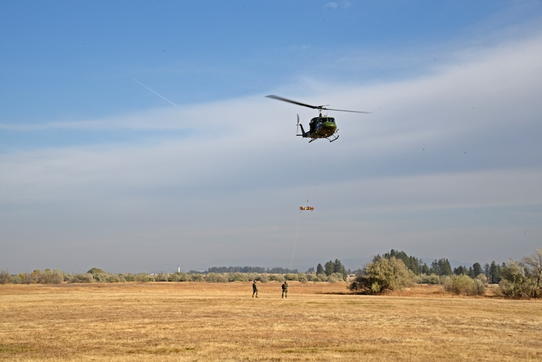 Airmen from the 36th Rescue Squadron demonstrate a medevac situation during the congressional staffer's base tour Oct. 18, 2018, at Fairchild Air Force Base, Washington. Following the medevac demonstration, congressional staffers were able to speak with 36th RQS aircrew members about their rescue experiences within the Pacific Northwest region. (U.S. Air Force photo/Staff Sgt. Mackenzie Mendez)