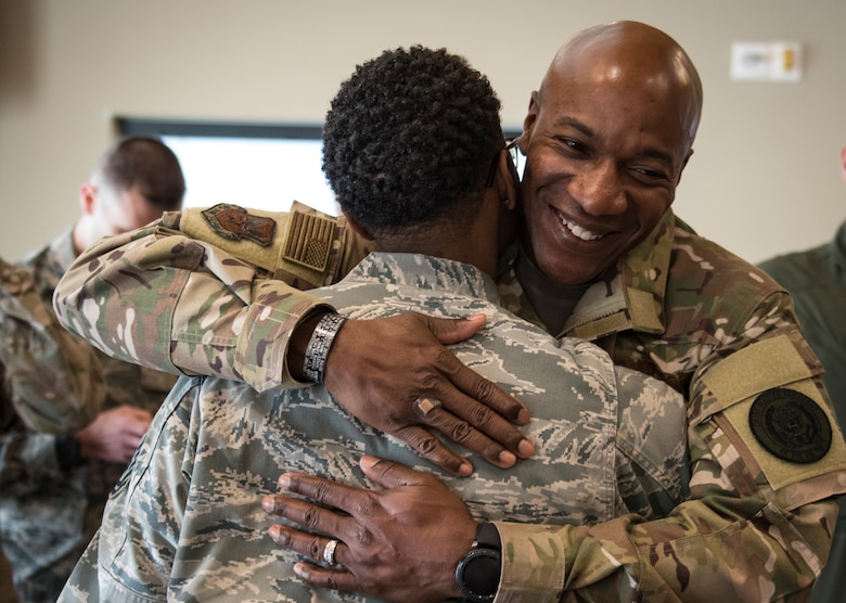 Chief Master Sgt. of the Air Force Kaleth O. Wright greets one of his former Airmen, Tech. Sgt. Amanda Taylor, 726th Operations Group command support staff superintendent, during a base tour Oct. 19, 2018 at Nellis Air Force Base, Nevada. Wright and Taylor were stationed together at Osan Air Base, South Korea, between 2007 and 2008 where they used to play basketball together. (U.S. Air Force photo by Airman 1st Class Andrew D. Sarver)