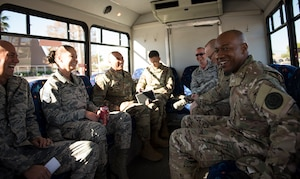 Chief Master Sgt. of the Air Force Kaleth O. Wright shares a laugh with base leadership during a tour Oct. 19, 2018, at Nellis Air Force Base, Nevada. Wright and his team traveled to multiple units across Nellis AFB to meet Airmen and learn about the different roles and responsivities that they have. (U.S. Air Force photo by Airman 1st Class Andrew D. Sarver)