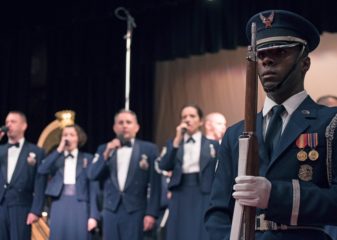 Senior Airman Joron Foster, U.S. Air Force Honor Guard ceremonial guardsman, participates in displaying of the colors before a U.S. Air Force Band performance at the Karen D. Young Memorial Auditorium in Van Horn, Texas, Oct. 20, 2018. Band performances aim to positively impact the community and inspire patriotism. (U.S. Air Force photo by Senior Airman Abby L. Richardson)
