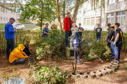 Members of Kaiserslautern area Boy Scout Troop 232 work on a student memorial restoration project led by Nathan Perez on October 6, 2018 at what is now Kaiserslautern Middle School.  While this is Perez's Eagle Scout project, it is meant to honor the memory of Erick Lynch, a Kaiserslautern American High School student and Boy Scout, who was killed in 1998, and to whom this statue was dedicated that year.  Over the years, the memorial had fallen into neglect. (U.S. Army Reserve Photo by Sgt. 1st Class John Freese, 7th MSC Public Affairs)