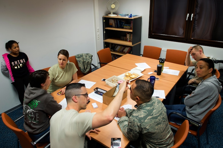 "U.S. Airmen assigned to the 86th Medical Operations Squadron apply makeup on volunteer victims before sending them out around the Kaiserslautern Military Community as part of an experiment in support of Domestic Violence Awareness Month on Ramstein Air Base, Germany, Oct. 17, 2018. Each Airman took at least 10 business cards with the phrase ""Thank you for asking,"" as well as additional resources for domestic violence victims and reporters to give to people who asked about their simulated injuries. More than 60 cards went out with the Airmen, they only gave 20 away. (U.S. Air Force photo by Staff Sgt. Jonathan Bass)"