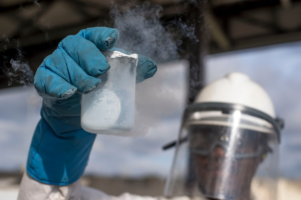 U.S. Air Force Senior Airman Kameron Ware, 100th Logistics Readiness Squadron Fuels Facilities operator, tests 200 milliliters of liquid oxygen at RAF Mildenhall, England, Oct. 2, 2018. Facilities Airmen wear protective equipment while testing liquid oxygen due to the low temperature of - 297 degrees Fahrenheit. (U.S. Air Force photo by Staff Sgt. Christine Groening)