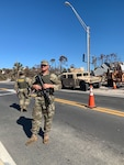 Soldiers assigned to Company D., 1st Battalion, 124th Infantry Regiment direct vehicles at a check point in Mexico Beach, Fla following Hurricane Michael, Oct. 21, 2018.