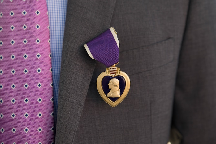 Marine veteran Matthew R. Follett was presented with a Purple Heart in Pasadena, Calif. on October 19, 2018. SSgt Follett received the award for injuries sustained while serving as an active duty counter intelligence specialist with 3rd Battalion, 4th Marine Regiment, 1st Marine Division, on January 7, 2010. (U.S.  Marine Corps photo by Lance Cpl. Samantha Schwoch/released)