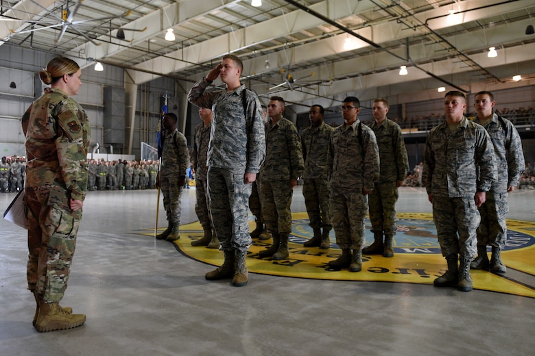 Airmen from the 312th Training Squadron salute a judge before starting their regulation drill during the quarterly drill competition at the Louis F. Garland Department of Defense Fire Academy on Goodfellow Air Force Base, Texas, Oct. 19, 2018. Each squadron performed regulation drill, marching through a standard set of maneuvers. (U.S. Air Force photo by Senior Airman Randall Moose/Released)