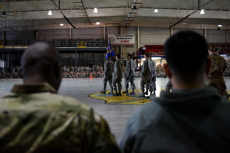 U.S. Air Force Chief Master Sgt. Lavor Kirkpatrick, 17th Training Wing command chief, and Col. Ricky Mills, 17th TRW commander, watch the quarterly drill competition at the Louis F. Garland Department of Defense Fire Academy on Goodfellow Air Force Base, Texas, Oct. 19, 2018. Goodfellow hosted the quarterly drill competition allowing the 312th Training Squadron, 315th TRS and the 316th TRS to show their drill and marching skills. (U.S. Air Force photo by Senior Airman Randall Moose/Released)