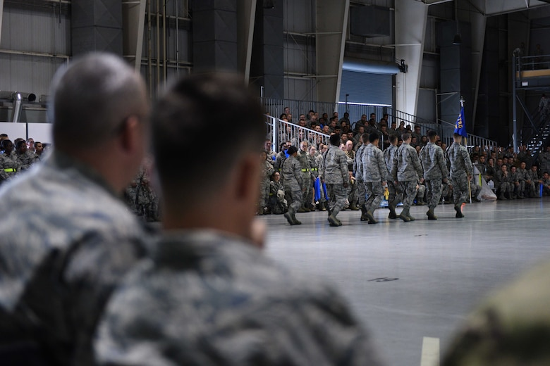 U.S. Air Force Chief Master Sgt. Daniel Stein, 17th Training Group superintendent, and Col. Thomas Coakley, 17th TRG commander, watch the quarterly drill competition at the Louis F. Garland Department of Defense Fire Academy on Goodfellow Air Force Base, Texas, Oct. 19, 2018. Leadership, including squadron commanders, came out to celebrate and cheer for their squadrons. (U.S. Air Force photo by Senior Airman Randall Moose/Released)