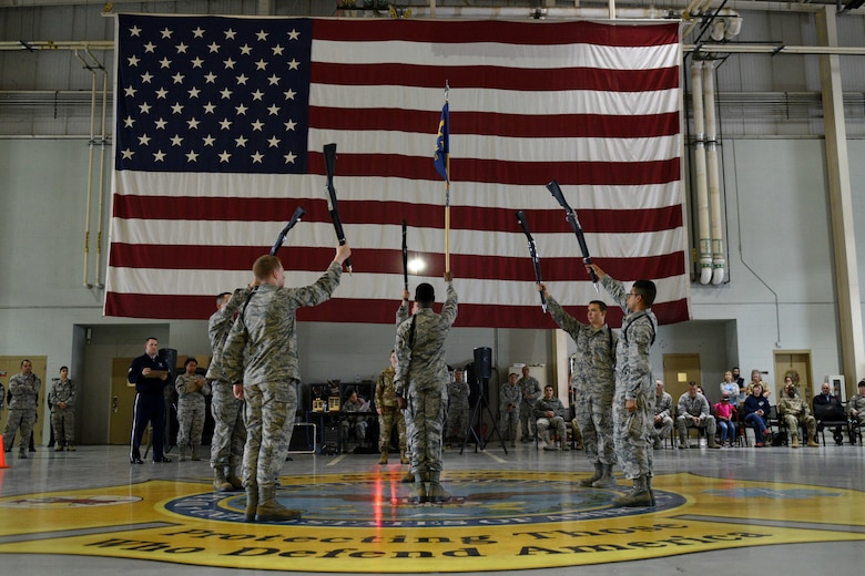 Airmen form the 312th Training Squadron perform an exhibition drill during the quarterly drill competition at the Louis F. Garland Department of Defense Fire Academy on Goodfellow Air Force Base, Texas, Oct. 19, 2018. Each squadron displayed their exhibition drill, using creative, free-form drill maneuvers. (U.S. Air Force photo by Senior Airman Randall Moose/Released)