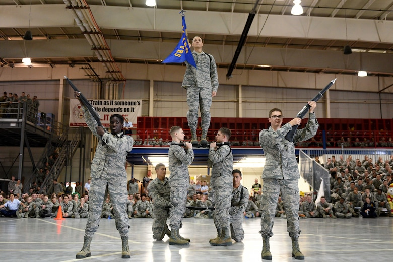 Airmen from the 316th Training Squadron perform an exhibition drill during the quarterly drill competition at the Louis F. Garland Department of Defense Fire Academy on Goodfellow Air Force Base, Texas, Oct. 19, 2018. Competitors performed creative salutes to finish their exhibition drills.  (U.S. Air Force photo by Senior Airman Randall Moose/Released)
