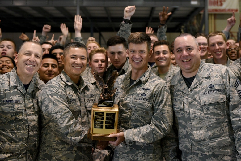 U.S. Air Force Chief Master Sgt. Jason Funkhauser 315th Training Squadron chief enlisted manager, and Lt. Col. Mark Chang, 315th TRS commander, receive the quarterly drill competition trophy from Col. Thomas Coakley, 17th Training Group commander, and Chief Master Sgt. Daniel Stein, 17th TRG superintendent, at the Louis F. Garland Department of Defense Fire Academy on Goodfellow Air Force Base, Texas, Oct. 19, 2018. The winning group will be performing at Lackland AFB, San Antonio. (U.S. Air Force photo by Senior Airman Randall Moose/Released)