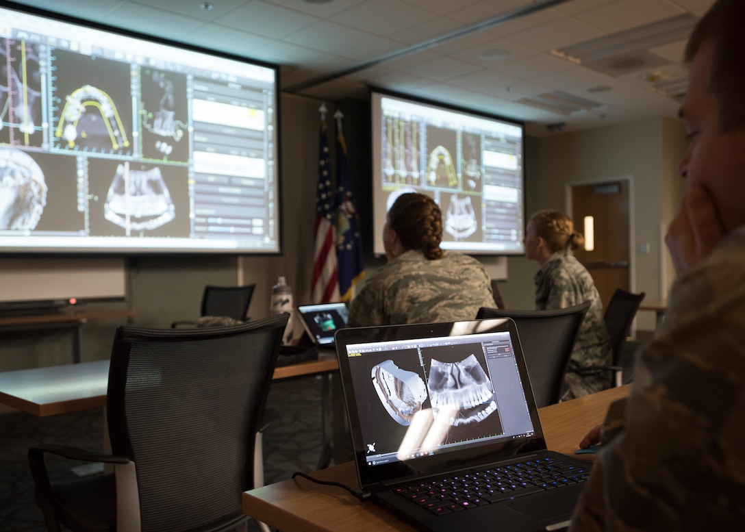 Dental specialists learn how to merge x-ray images and 3D imagery into one during the Prosthodontics update course at the Air Force Postgraduate Dental School, Joint Base San Antonio-Lackland, Texas. The specialists created virtual dental implants and printed them into a 3D model. (U.S. Air Force photo by Staff Sgt. Kevin Iinuma)