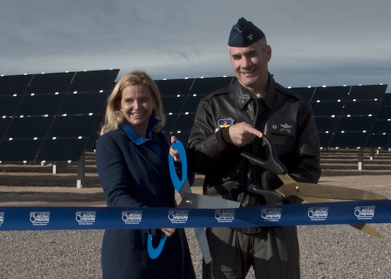 Col. Joseph L. Campo (right), 49th Wing commander, and Mary Kipp (left), El Paso Electric CEO, cut a ribbon at the solar array opening ceremony Oct. 19 on Holloman Air Force Base, N.M. The solar array is made up of almost 56,000 thin-film modules that will generate enough electricity to power more than 1,700 homes annually, prevent emissions by over 9,000 metric tons and save approximately nine million gallons of water. (U.S. Air Force photo by Airman 1st Class Kindra Stewart)