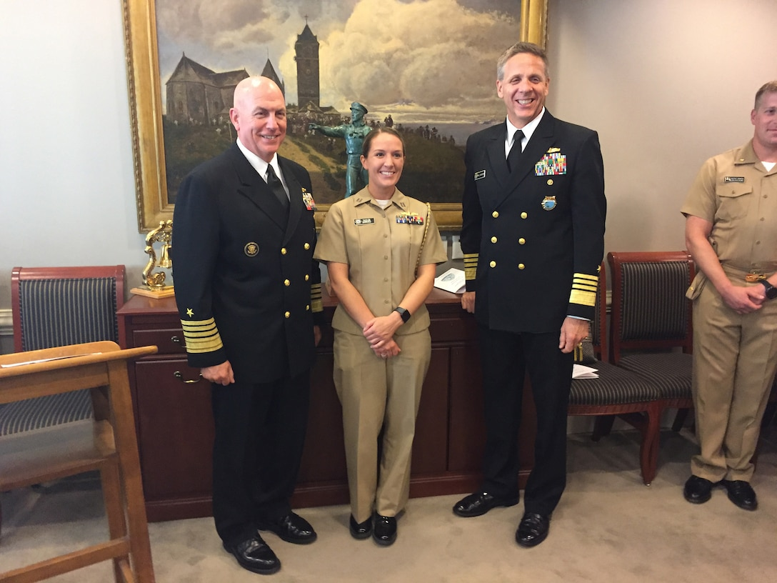Old Salt emeritus Navy Adm. Kurt Tidd, the commander of U.S. Southern Command, left, and new Old Salt Navy Adm. Philip Davidson, the commander of U.S. Indo-Pacific Command, stand with Navy Lt. Taylor Randall, who earned her surface warfare pin aboard the cruiser USS Vella Gulf in 2016.