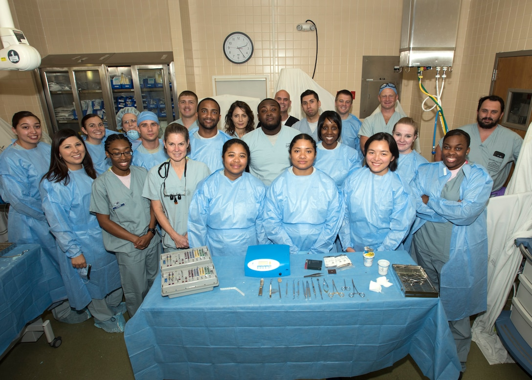 Dental specialist and technicians take a group photo after their surgical training portion of the Prosthodontics update course on Joint Base San Antonio-Lackland, Texas. The seven day curriculum provides advanced hands-on and didactic training for dental specialists. (U.S. Air Force photo by Staff Sgt. Kevin Iinuma)