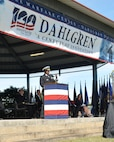 "IMAGE: DAHLGREN, Va. (Oct. 19, 2018) – Naval Surface Warfare Center Dahlgren Division (NSWCDD) Commanding Officer Capt. Godfrey 'Gus' Weekes recounts the highlights of Dahlgren's history before the military and civilian audience gathered to celebrate the NSWCDD centennial. ""The men and women of Dahlgren are dedicated to the mission and have always answered the bell,"" said Weekes, recounting the technological impact NSWCDD has made to the Navy and nation ""We answered the bell in 1918 and we're answering the bell today. Just like during the Cold War or the Korean War, we're up against near peer or peer threats. The need for Dahlgren is never more apparent."""