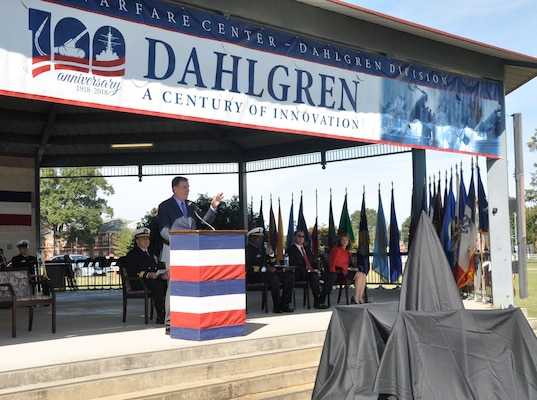 "IMAGE: DAHLGREN, Va. (Oct. 19, 2018) – U.S. Senator Mark Warner lists a series of Dahlgren achievements from World War II long guns to global positioning system technology while speaking to the military and civilian audience gathered to celebrate the NSWCDD centennial. ""This is an installation where a great deal of innovation and collaboration take place,"" said Warner. ""We're going to need that same level of collaboration, cutting edge experimentation as we move forward for the next 100 years, not only to protect our country but to make sure that we're able to match the innovation and have the kind of protections that will keep this nation strong, safe and free. So, for all you've done for the last 100 years, I say thank you."""