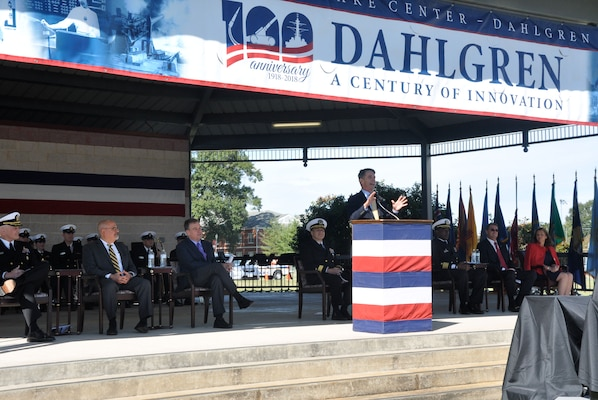 "IMAGE:DAHLGREN, Va. (Oct. 19, 2018) – U.S. Representative Rob Wittman emphasizes the importance of doing more with available resources to increase technological capabilities than the adversaries of the United States can do with their resources. ""Today, it's about the creation and innovation that goes into doing more with what we have than anybody around the world,"" said Wittman, while speaking at the NSWCDD centennial grand finale. ""We have done that, we can do that, and we will continue to do that to make sure that our nation's Navy, Marine Corps, Air Force, Army and indeed our Coast Guard, continue to be the greatest the world has ever known because we have the best and brightest men and women serving our nation both in uniform and here at the base in making sure that we have what we need to defend our nation's interest."""