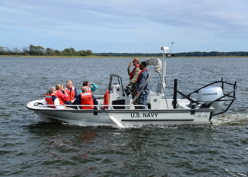 """Members of the Joint Base Charleston Advisory Council attended an """"area of responsibility"""" boat tour with members of the Waterfront Port Operations Oct. 18, 2018, at Joint Base Charleston's Naval Weapons Station. The mission of the Joint Base Charleston Advisory Council is to serve as advocates and liaisons between community and military leaders on issues affecting Joint Base Charleston and its military partners."""