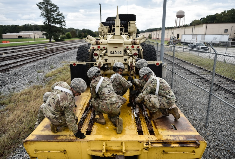 U.S. Army Soldiers from the 119th Inland Cargo Transfer Company, 11th Transportation Battalion, 7th Transportation Brigade (Expeditionary), conduct rail load operations during a training exercise at Joint Base Langley-Eustis, Virginia, Oct. 17, 2018.