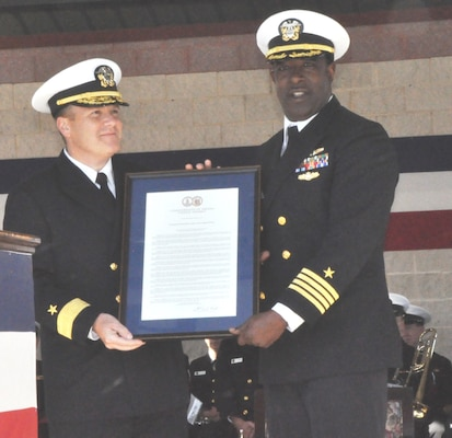 IMAGE: DAHLGREN, Va. (Oct. 19, 2018) – Rear Adm. Tom Anderson, Naval Surface Warfare Center (NSWC) commander, and Capt. Godfrey 'Gus' Weekes, NSWC Dahlgren Division commanding officer hold the Virginia General Assembly Resolution proclaiming Oct. 16 as Dahlgren Day during the grand finale celebration of the NSWC Dahlgren Division centennial. Virginia State Sen. Richard Stuart and Virginia Delegate Margaret Ransone read and presented the resolution at the event.