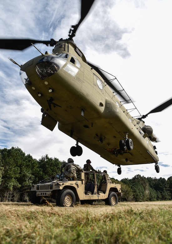 U.S. Army Soldiers from the 11th Transportation Battalion, 7th Transportation Brigade (Expeditionary), conduct sling load operations during a training exercise at Joint Base Langley-Eustis, Virginia, Oct. 17, 2018.