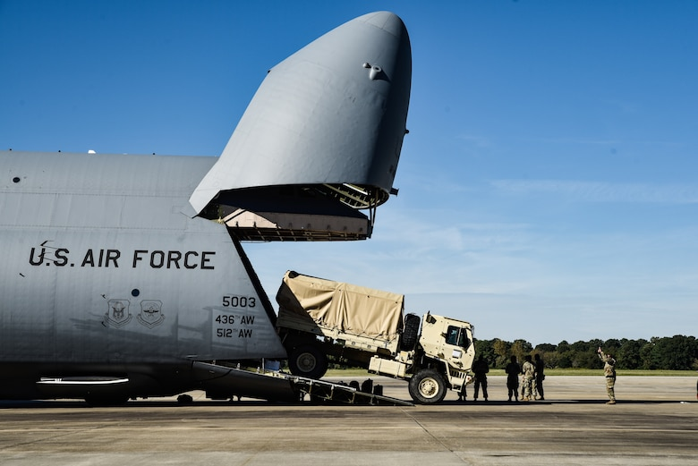 U.S. Army Soldiers from 149th Inland Cargo Transfer Company, 11th Transportation Battalion, 7th Transportation Brigade (Expeditionary), load a LMTV onto a C-5M Super Galaxy from the 9th Airlift Squadron from Dover Air Force Base, Delaware, during a training exercise at Joint Base Langley-Eustis, Virginia, Oct. 19, 2018.