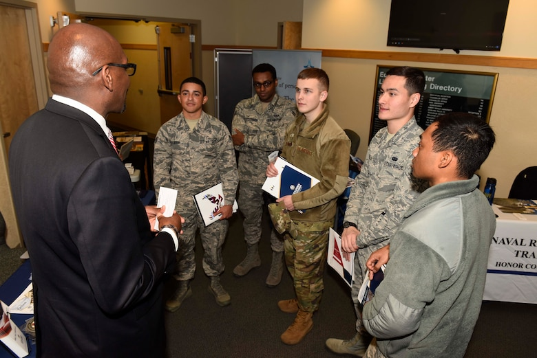 A group of Airmen listen to a college representative about opportunities in furthering education at the 2018 Fairchild Air Force Base Education Fair at Fairchild Air Force Base, Washington, Oct. 18, 2018. The education center houses five different univiersities and colleges allowing Airmen the opportunity to further their education. (U.S. Air Force photo/ Airman 1st Class Lawrence Sena)