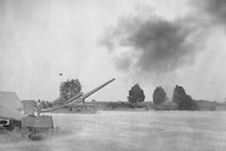 IMAGE: DAHLGREN, Va. (Oct. 16, 1918) – On this date in Naval Surface Warfare Center Dahlgren Division (NSWCDD) history, Marines supervised by Lt. Cmdr. H.K. Lewis successfully test fired an Army seven-inch, 45-caliber, tractor-mounted gun, marking the establishment of Dahlgren as a Naval Proving Ground on Oct. 16, 1918. Since that shot was fired, Dahlgren scientists and engineers rose to the occasion time and again to provide the Navy with innovative solutions based on their technical capability to integrate sensors, weapons, and associated weapon and combat systems into surface ships and vehicles.