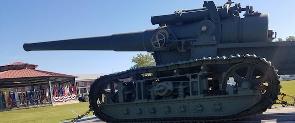 "IMAGE: DAHLGREN, Va. (Oct. 19, 2018) –  A restored World War I era gun presides over the Naval Surface Warfare Center Dahlgren Division (NSWCDD) grand finale celebration of the NSWC Dahlgren Division centennial. ""The first shot of the new base was fired from a seven-inch, 45-caliber, tractor-mounted gun, just like the one over there,"" said Capt. Godfrey 'Gus' Weekes, NSWCDD commanding officer, while pointing to the century-old gun on display. Since that shot was fired on Oct. 16, 1918, Dahlgren scientists and engineers rose to the occasion time and again to provide the Navy with innovative solutions based on their technical capability to integrate sensors, weapons, and associated weapon and combat systems into surface ships and vehicles."