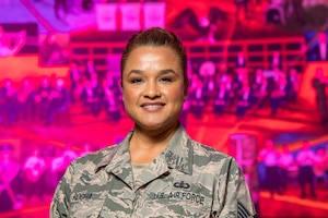 U.S. Air Force Tech. Sgt. Melissa Rocha, USAF Band of the Golden West section chief, poses for a photo at Travis Air Force Base, California, Oct. 23, 2018. In March 2017, Rocha was diagnosed with ductal carcinoma in situ, a form of breast cancer, she has undergone a symphony of medical treatments at David Grant USAF Medical Center and is now living cancer free. (U.S. Air Force photo by Master Sgt. Joey Swafford)