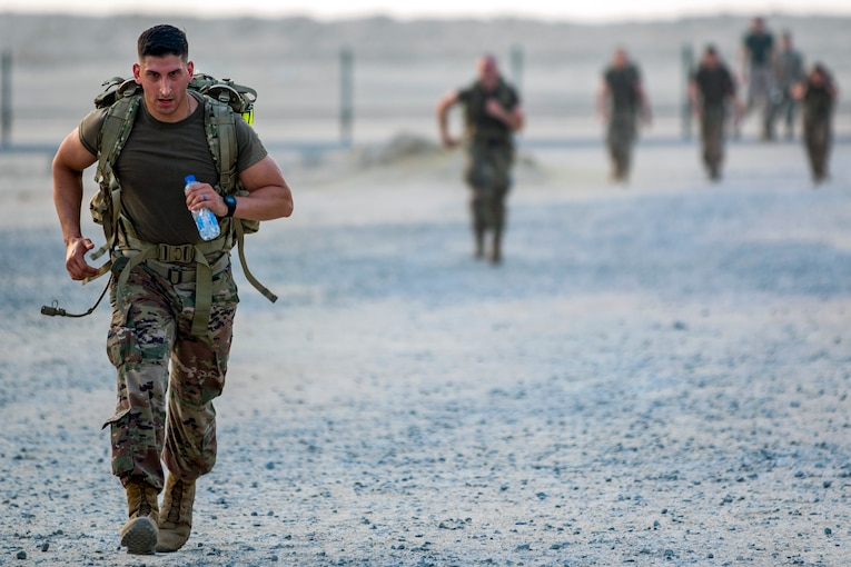 A soldier nears the finish line of a ruck march.