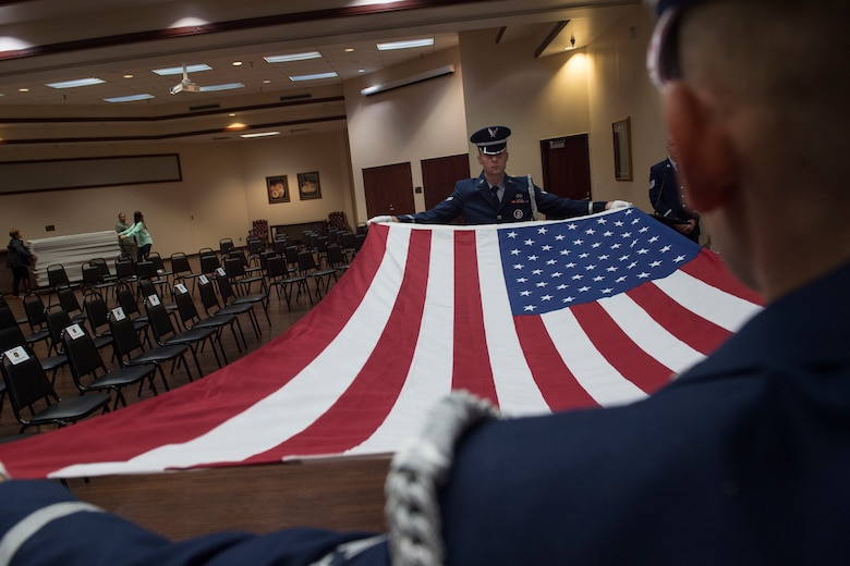 U.S. Air Force Airmen assigned to the 97th Air Mobility Wing Honor Guard team, fold the U.S. flag during a practice ceremony, Oct. 19, 2018, at Altus Air Force Base, Okla.