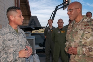 Gen. CQ Brown Jr., Pacific Air Forces commander, speaks with Airman 1st Class Nathan Barboza, 154th Civil Engineering Squadron emergency management assistant, during a visit to Hawaii Air National Guard F-22 Raptor operations facilities at Joint Base Pearl Harbor-Hickam, Hawaii, Oct. 19, 2018. During the visit, Brown had an up-close look at the total force integration construct of the Hawaiian Raptors which blends Guard and active duty personnel into one cohesive operation. (U.S. Air National Guard photo by Senior Airman Orlando Corpuz)