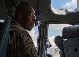 Gen. CQ Brown Jr., Pacific Air Forces commander, prepares for a cargo air drop mission on a C-17 Globemaster III, during his visit to the 15th Wing, Joint Base Pearl Harbor-Hickam, Hawaii, Oct. 19, 2018.  During his visit, Brown discussed innovation and total force integration with Airmen throughout the 15th Wing, the gateway of the Indo-Pacific. (U.S. Air Force photo by Tech. Sgt. Heather Redman)
